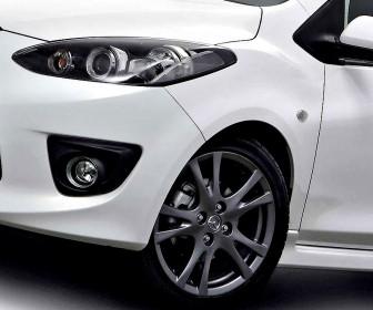 Mazda 2 Headlight And Front Wheel Wallpaper