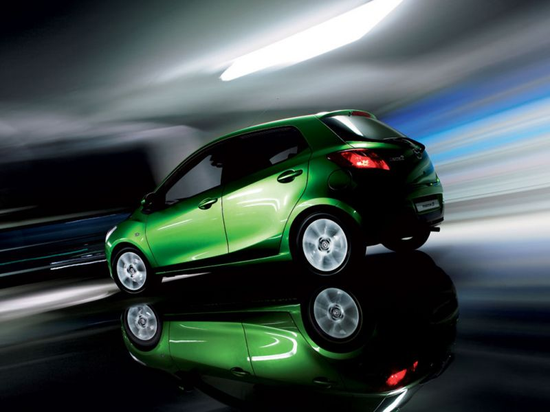 Mazda 2 Lime Green Side And Rear Angle Moving Wallpaper 800x600