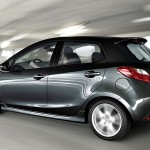 Mazda 2 Silver Side And Rear Angle Moving Wallpaper