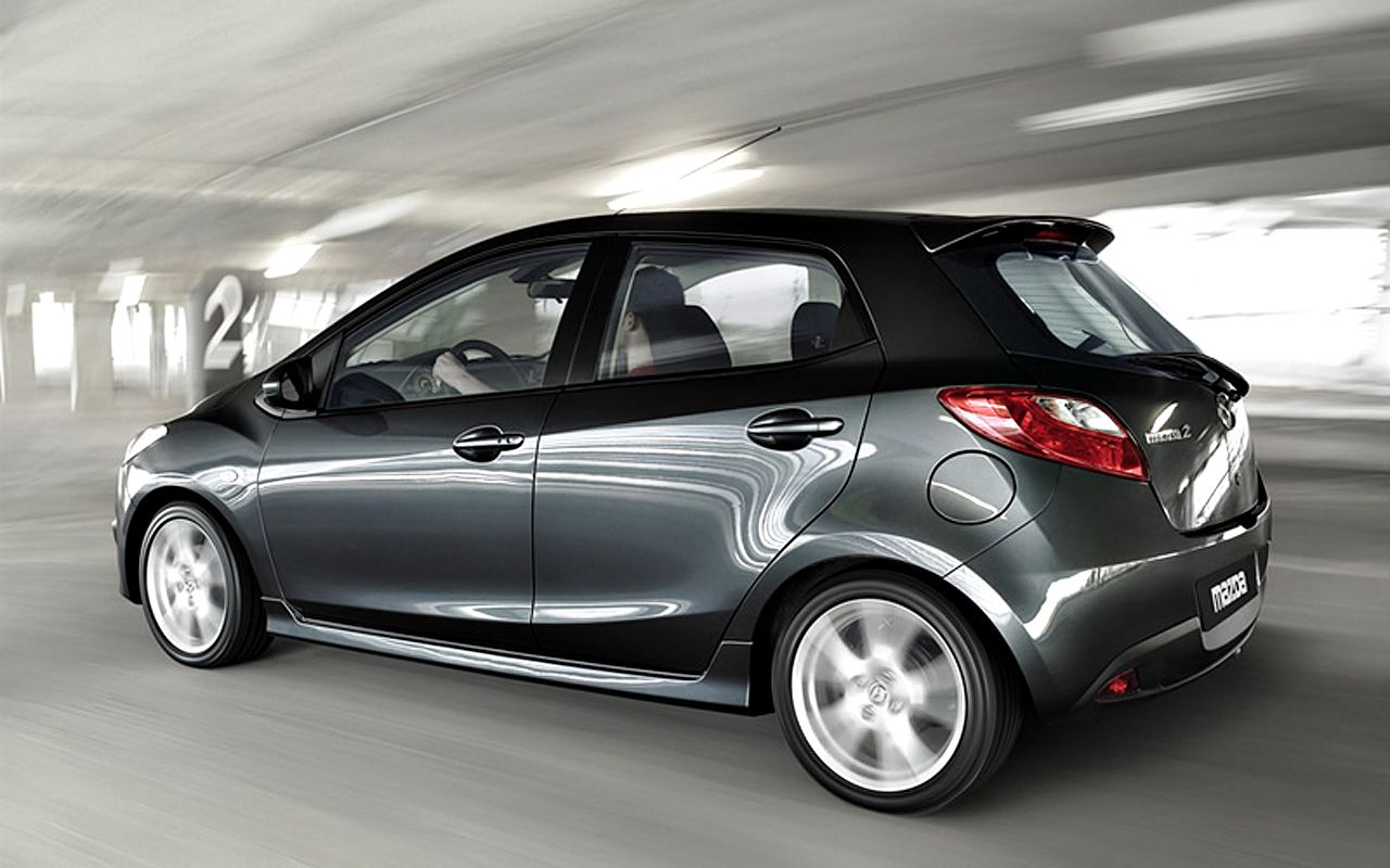 Mazda 2 Silver Side And Rear Angle Moving Wallpaper 1280x800