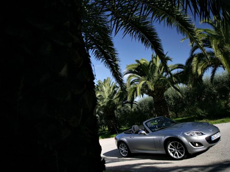 palm trees background. Mazda Mx5 Silver Palm Trees