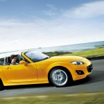 Mazda Mx5 Yellow Roadster Side View Moving Wallpaper