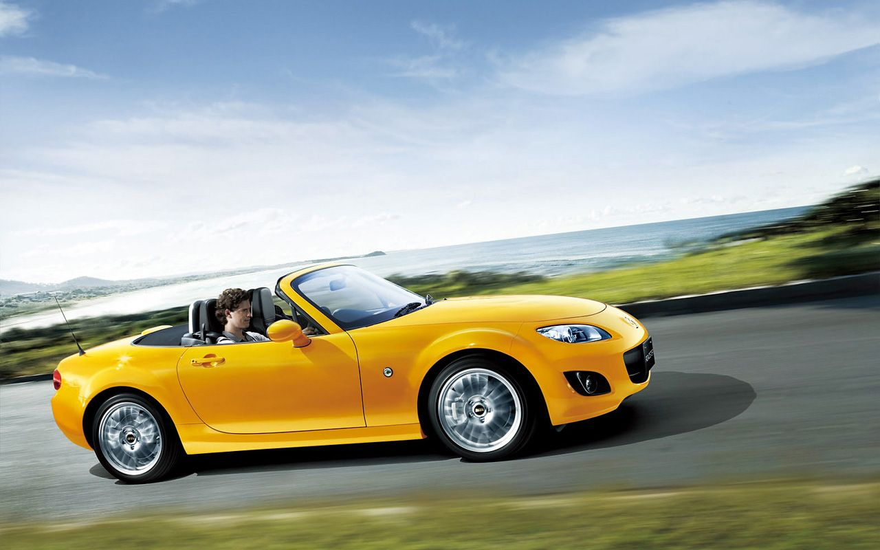 Mazda Mx5 Yellow Roadster Side View Moving Wallpaper 1280x800